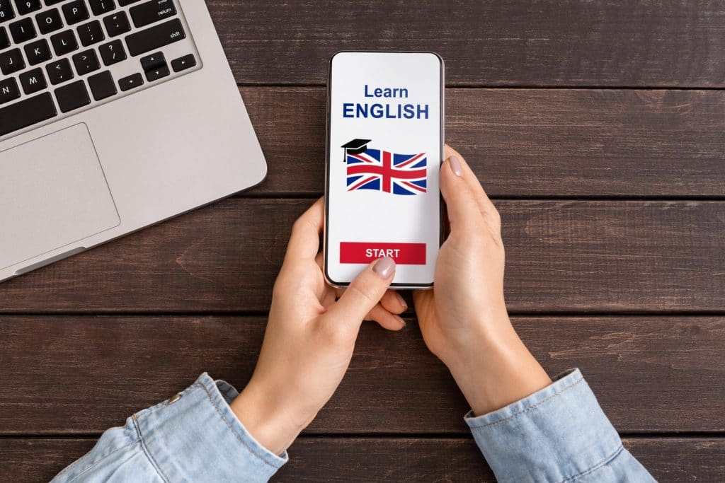 Woman Learning English With Language Application On Smartphone